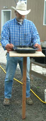 Filling the stepping stone mold on a work board